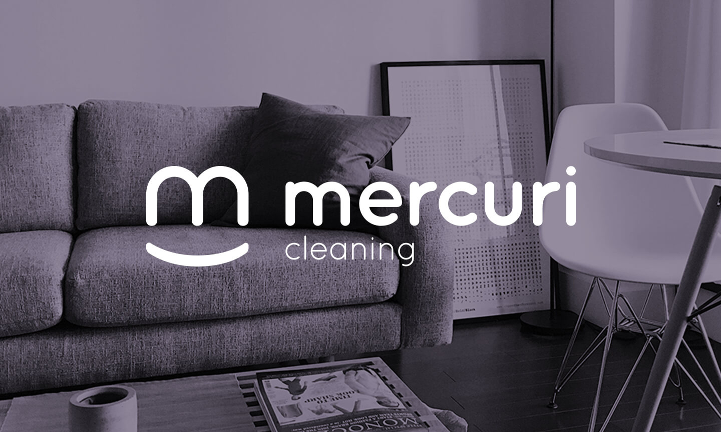 Mercuri Cleaning Company logo overlayed on a photo of a clean and minimalist style family room.